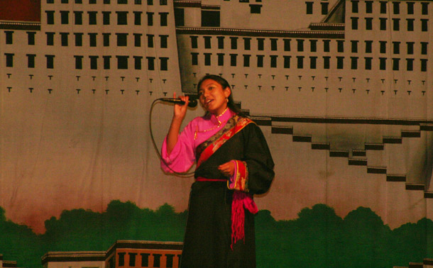 A Tibetan girl performs traditional song for
