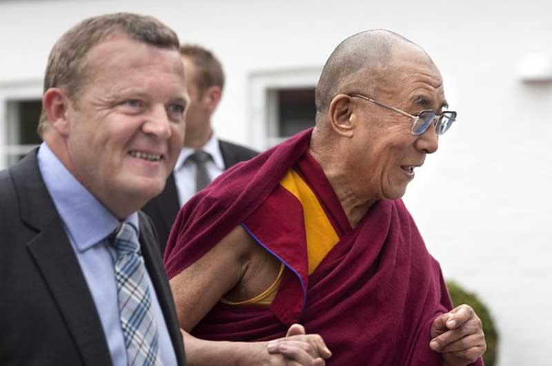 Copenhagen: His Holiness the Dalai Lama arrived here Friday afternoon and straight away proceeded in a motorcade, escorted by five Danish police motorcyclists, to first meet Danish Prime Minister Lars Løkke Rasmussen and later Foreign Minister Per Stig Møller. photo: Reuters