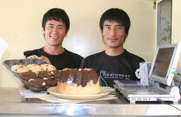 Tashi and his friend Yarphel, and the cakes for business in Dharamshala, India. Photo: TPI-S Hart