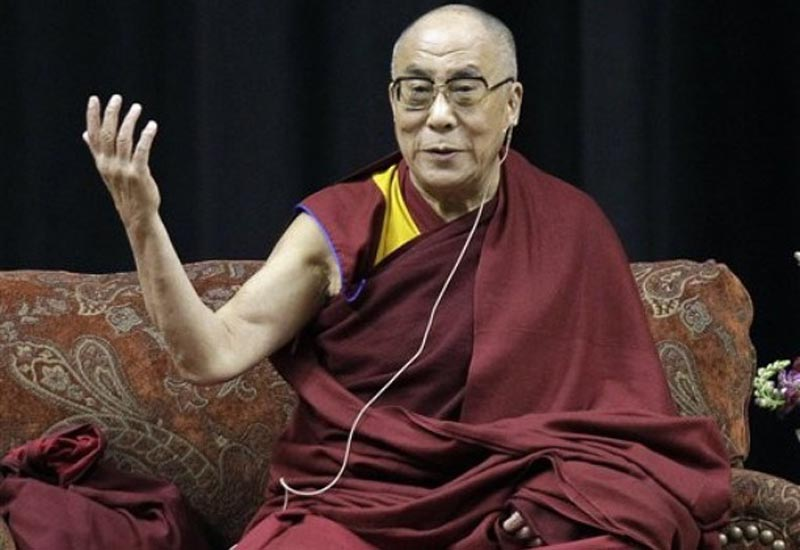 His Holiness the  Dalai Lama gestures as he speaks to an audience in Indianapolis, Friday,  May 14, 2010. AP