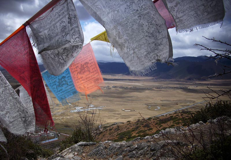 Viewing the Prayer flags from hill, Shangri La, eastern Tibet, March 2010. Photo: TPI/Mike Taylor