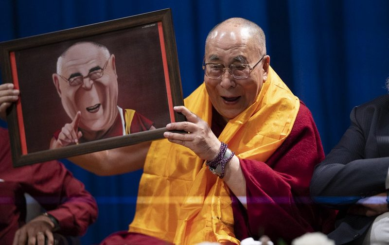 His Holiness holding a portrait presented to him by a student before his talk on compassion at Guru Nanak College of Arts, Science & Commerce in Mumbai, India on December 13, 2018. Photo: Lobsang Tsering