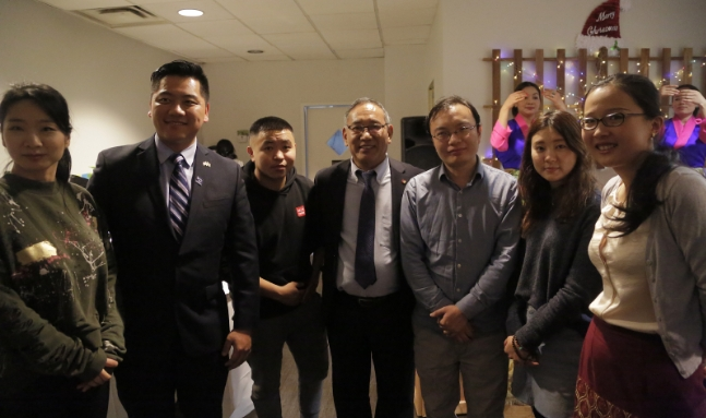 Representative Ngodup Tsering and Chinese Liaison Officer, Tsultrim Gyatso with Chinese youths at the exchange dinner event. Photo: Chinese Liaison Office, OOT Washington DC
