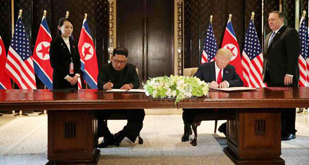 Trump and Kim Jong Un prepare to sign a document at the Capella hotel on Singapore's Sentosa island on Tuesday, June 12, 2018. Photo: Reuters