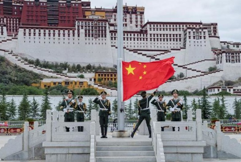 Chinese military forces raising the Chinese flag over Lhasa, Tibet. Photo: file