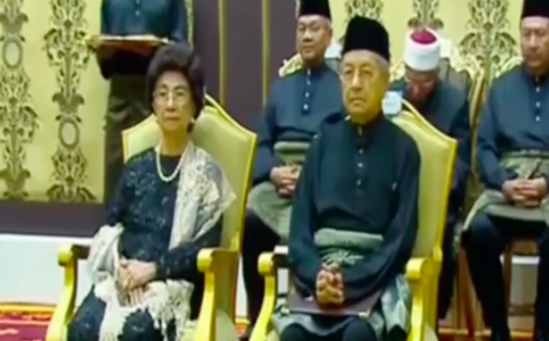 Dr Mahathir Mohamad and his wife Siti Hasmah Mohd during the swearing in ceremony. Photo: TNO