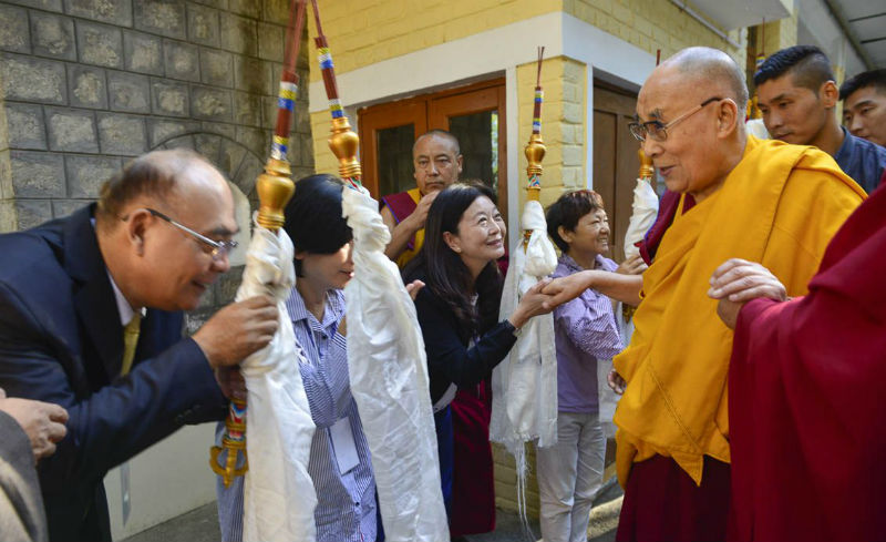 His Holiness greeting organizers on his way to the Main Tibetan Temple for the first day of his four day teaching in Dharamsala, HP, India on October 3, 2018. Photo: Ven Tenzin Jamphel