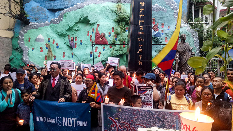 Tibetans and supporters holding a a candlelight vigil in solidarity with Hong Kongers at the Martyr's Pillar in McLeod Ganj, India during the evening on August 19, 2019. Photo: TPI/Yangchen Dolma
