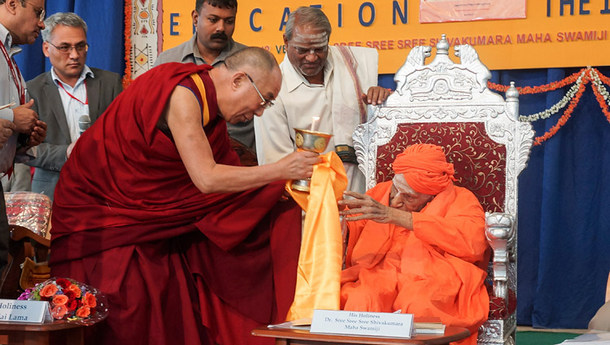 His Holiness offering a butter lamp to Sree Shivakumara Swamiji in Karnataka, India on November 27, 2012. Photo by Jeremy Russell