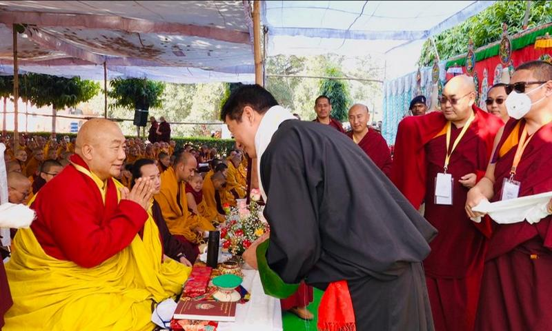 Sikyong greets Khenchen Rigzin Rinpoche at the Monlam festival in Bodh Gaya.