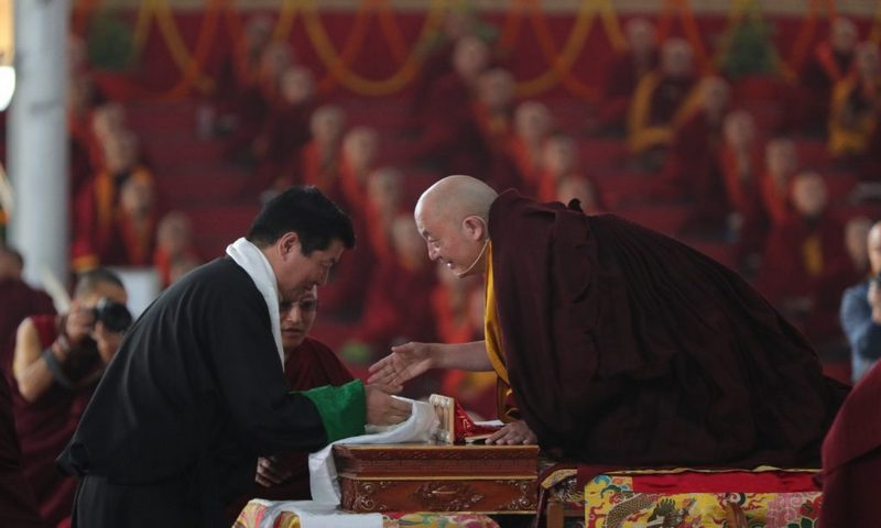 Sikyong greets Kyabje Tsurphu Goshir Gyaltsab Rinpoche at the 37th Kagyu Monlam Festival in Bodh Gaya.