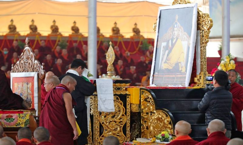 Sikyong Dr Lobsang Sangay pays obeisance as he greets to the portrait of Gyalwa Karmapa at the 37th Kagyu Monlam Festival in Bodh Gaya.