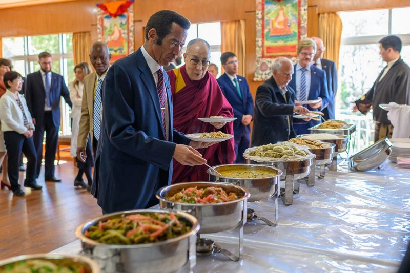 Former President of Botswana Ian Khama and His Holiness helping themselves to the different vegetarian dishes prepared for their luncheon at his residence in Dharamsala, HP, India on March 10, 2019. Photo by Tenzin Choejor