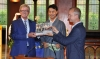Representative Tashi Phuntsok with MEP Thomas Mann and Vincent Metten, EU Policy Director, ICT releasing the book. Photo: Brussels OOT