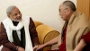 His Holiness the Dalai Lama with Narendra Modi. Photo: File