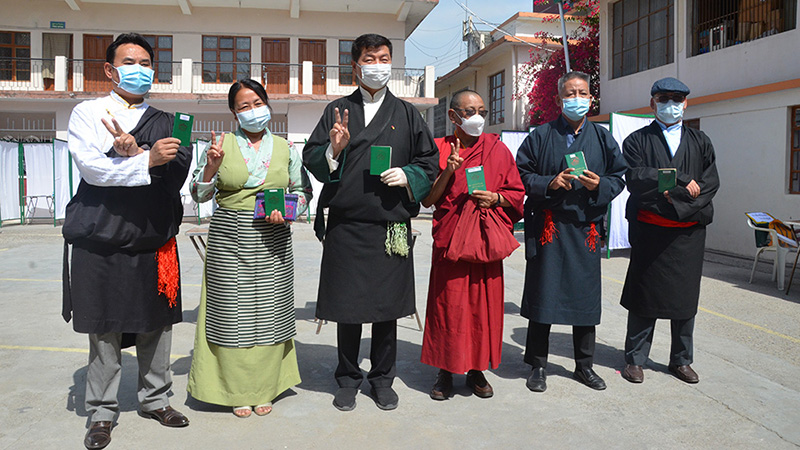 President Lobsang Sangay and ministers stood proudly with Tibetan green books in their hands after the vote on April 11, 2021. Photo:TPI/Yangchen Dolma