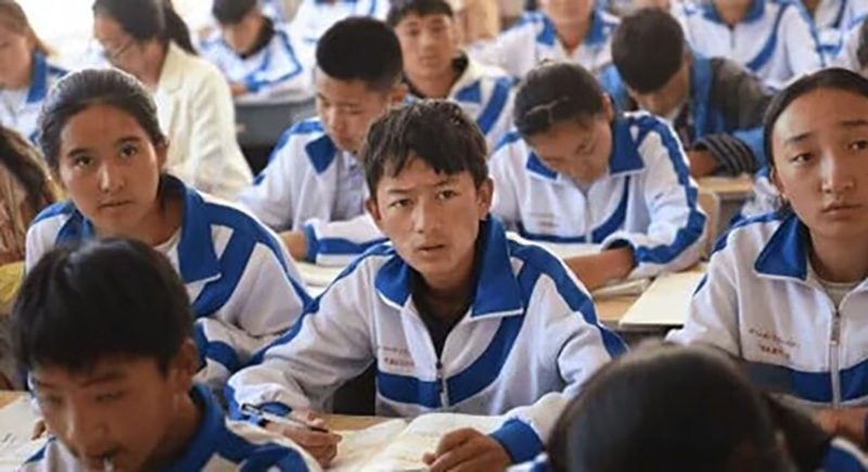 Chinese President Xi personally calling for an increased political education in schools in Tibet to ensure the loyalty of the next generation. Photo: Human Rights Watch