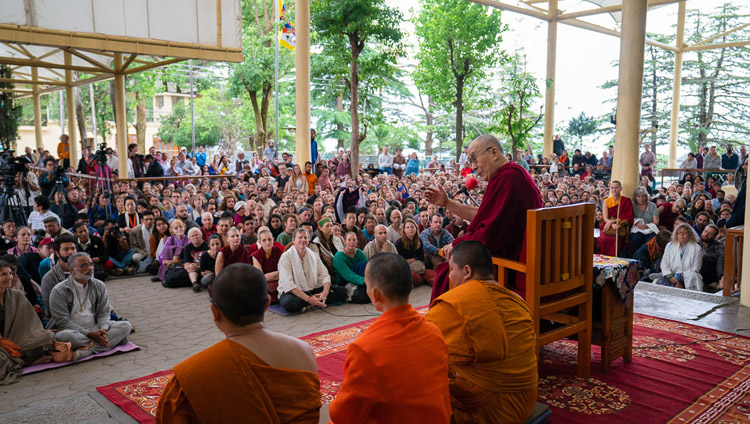His Holiness the Dalai Lama addressing the crowd of tourists from over 68 countries and India gathered at the Main Tibetan Temple courtyard in Dharamsala, HP, India on April 16, 2018. Photo by Tenzin Choejor