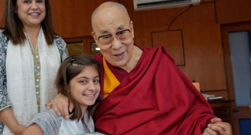 His Holiness the Dalai Lama speaking to a young girl at his residence in Dharamshala, HP, India on June 10, 2019. Photo: OHHDL