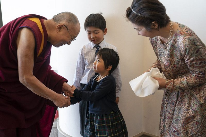 His Holiness the Dalai Lama fondly greeting the daughter of an old friend and supporter in Yokohama, Japan on November 16, 2018. Photo by Tenzin Choejor